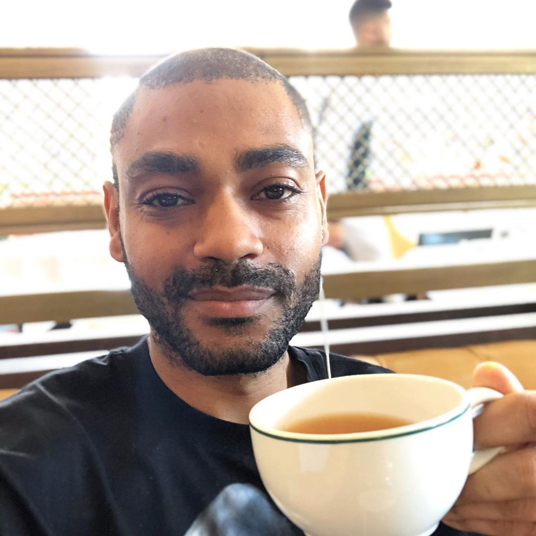 Image may contain: Top Boy cast, Top Boy, season 3, Netflix, Kane Robinson, Sully, Kano, Beverage, Drink, Face, Pottery, Cup, Coffee Cup, Human, Person