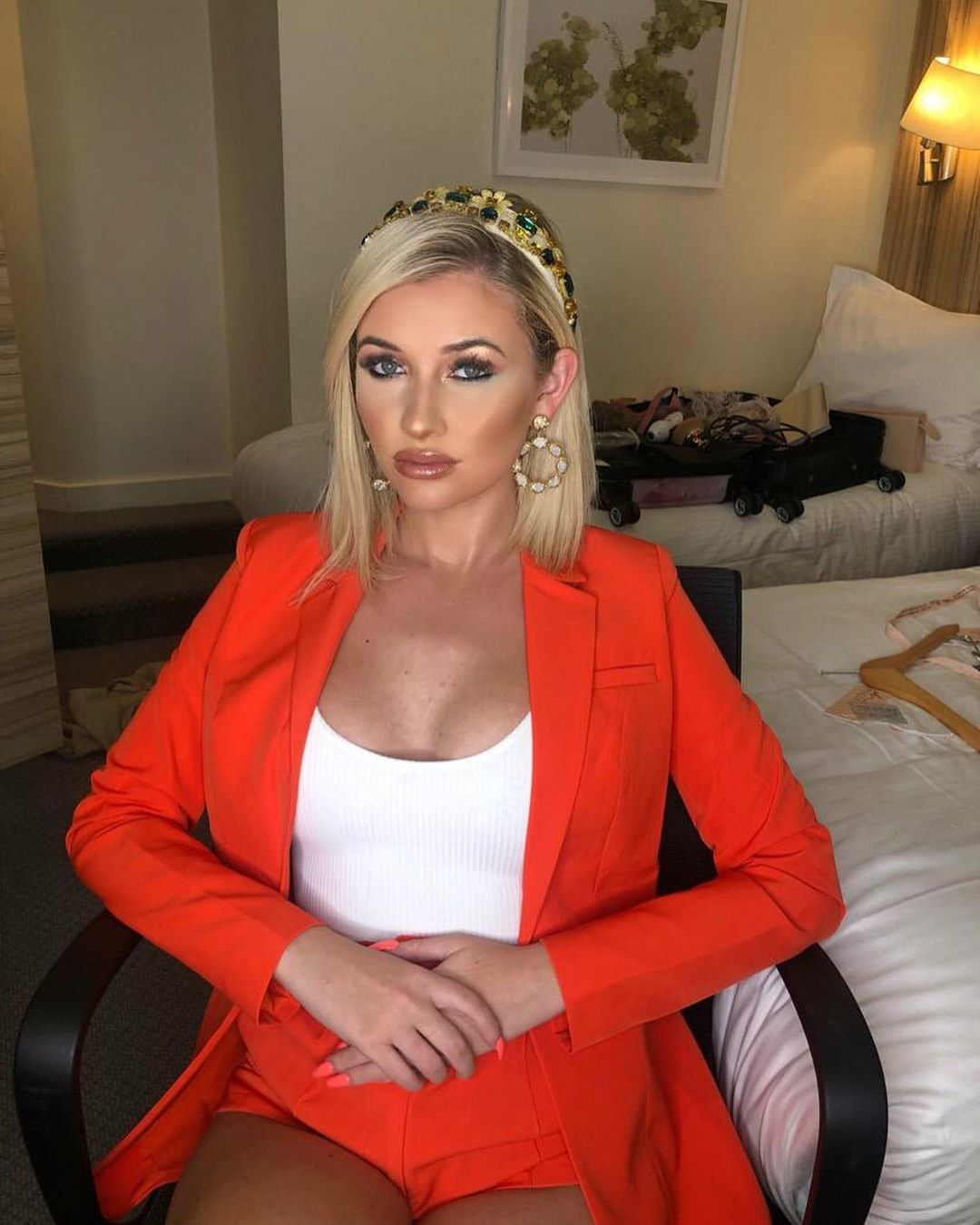 Image may contain:  Love Island 2019 contestants, Love Island, 2019, now, job, Instagram, updates, news, latest, series five, Amy Hart, Chair, Couch, Jacket, Blazer, Female, Girl, Blonde, Child, Kid, Woman, Teen, Suit, Overcoat, Coat, Person, Human, Furniture, Apparel, Clothing