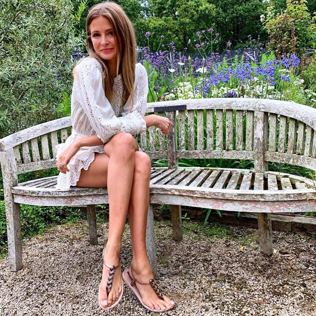 Image may contain: Made in Chelsea heirs, Made in Chelsea, MIC, family, fortunes, money, business, company, worth, cash, inheritance, Millie Mackintosh, Quality Street, Toffee, chocolate, invented, Clothing, Apparel, Outdoors, Garden, Sitting, Park Bench, Bench, Person, Human, Furniture