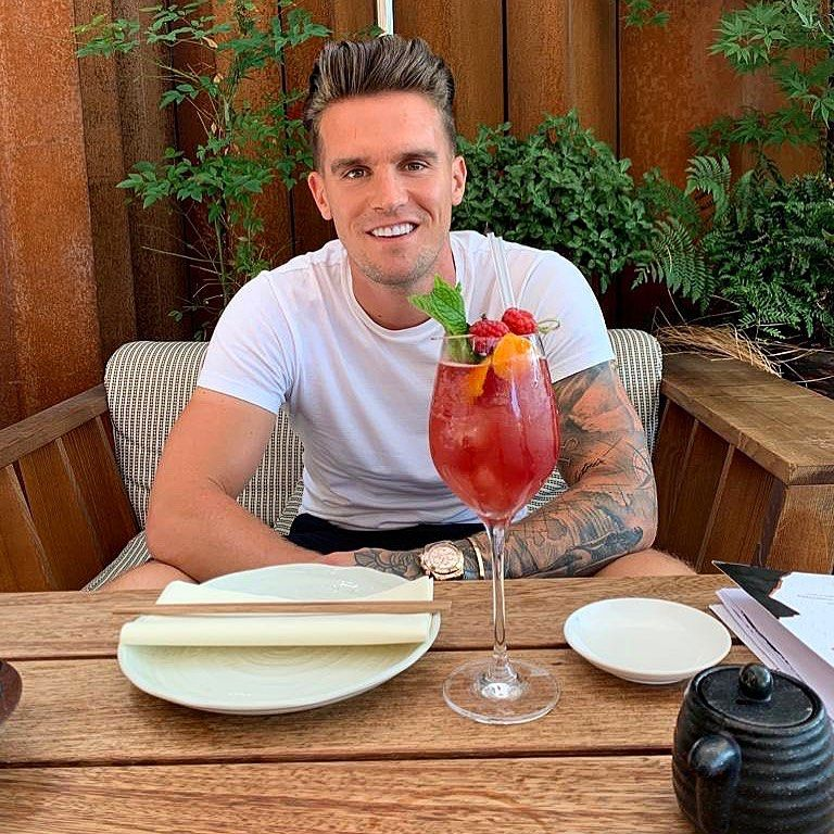 Image may contain: reality TV rich list, UK, reality TV, net worth, earnings, money, salary, rich, worth, Gaz Beadle, Geordie Shore, Hardwood, Plywood, Drink, Cocktail, Alcohol, Beverage, Person, Human, Wood