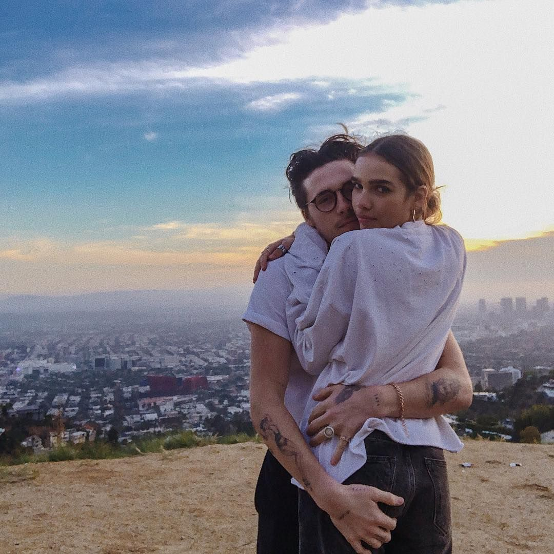 Image may contain: Brooklyn Beckham and Hana Cross, Brooklyn Beckham, Hana Cross, relationship, together, split, breakup, reason, argument, timeline, dating, drama, Instagram, Landscape, Man, Hug, Outdoors, Nature, Pants, Human, Person, Clothing, Apparel