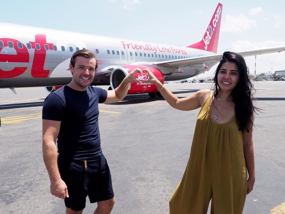 Image may contain: Love Island winners, couples, Love Island, together, split, Nathan, Cara, 2016, series two, Long Sleeve, Shorts, Airliner, Sleeve, Clothing, Apparel, Transportation, Aircraft, Airplane, Vehicle, Person, Human