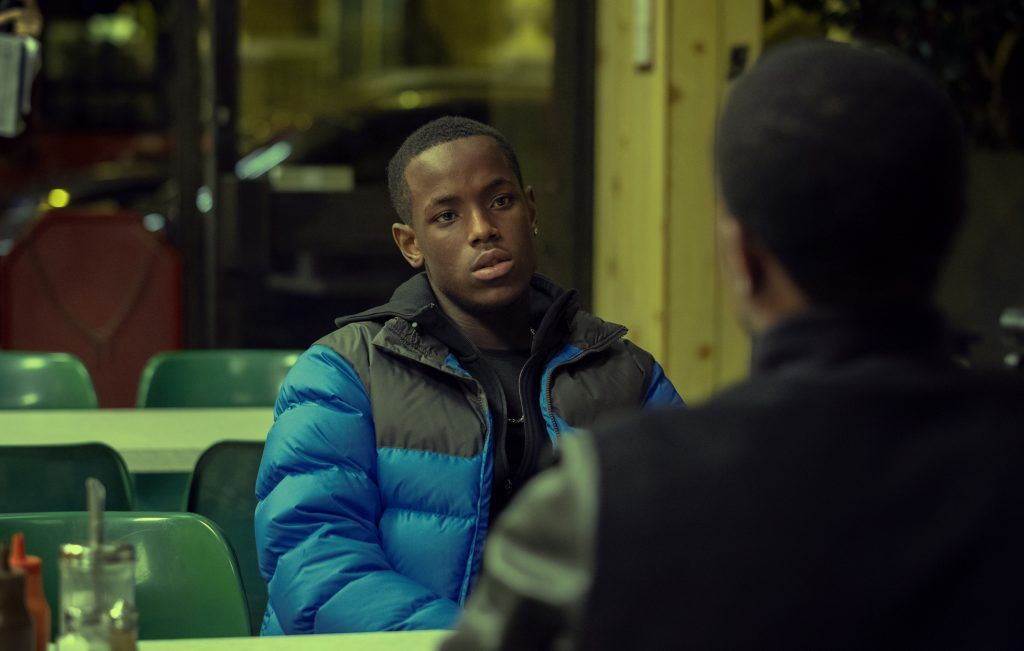 Image may contain: Top Boy cast, Top Boy, season 3, Netflix, Michael Ward, Jamie, Overcoat, Furniture, Chair, Sitting, Apparel, Clothing, Jacket, Coat, Person, Human