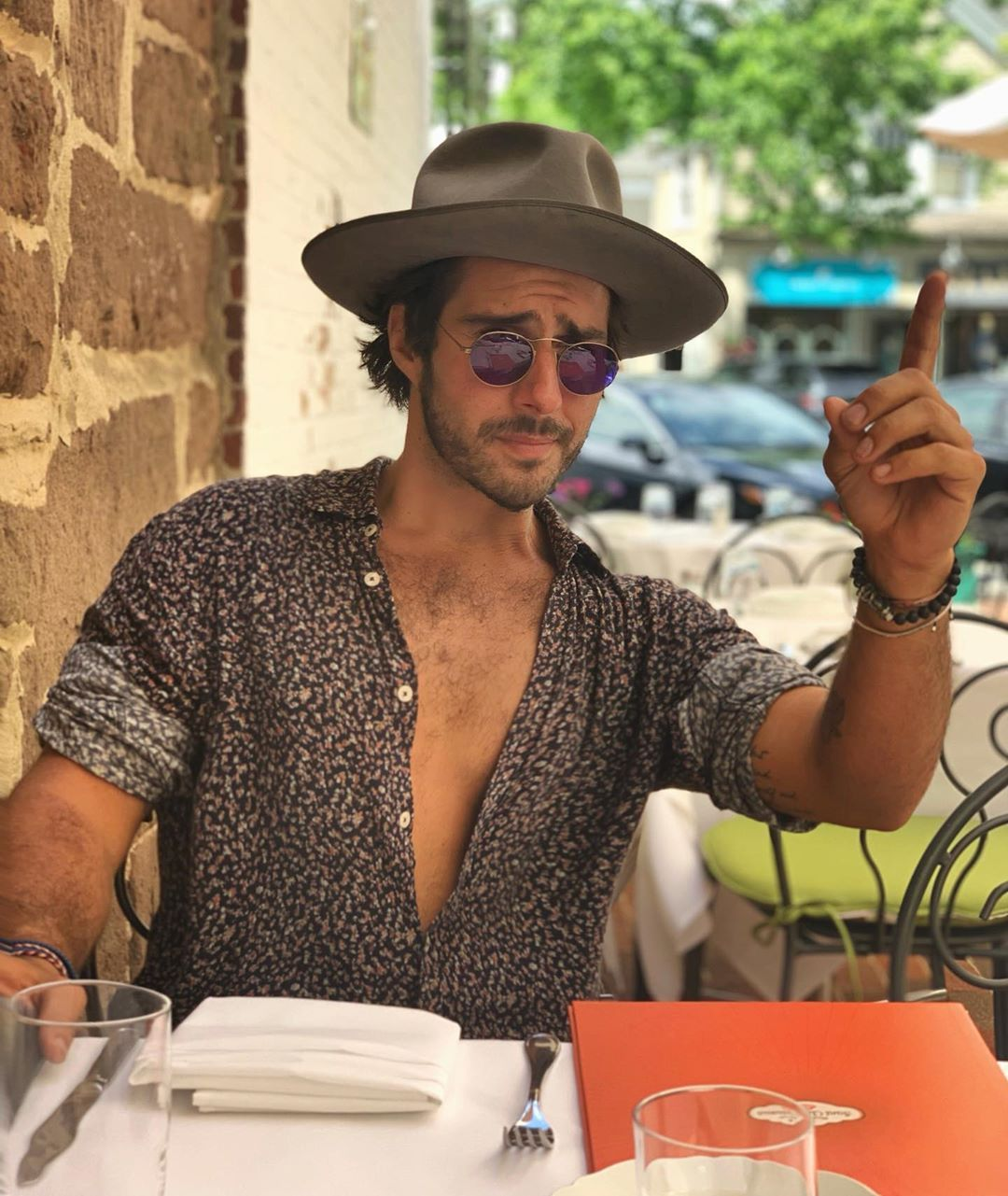 Image may contain: Made in Chelsea heirs, Made in Chelsea, MIC, family, fortunes, money, business, company, worth, cash, inheritance, Alik Alfus, Restaurant, Finger, Accessories, Sunglasses, Accessory, Clothing, Apparel, Hat, Human, Person