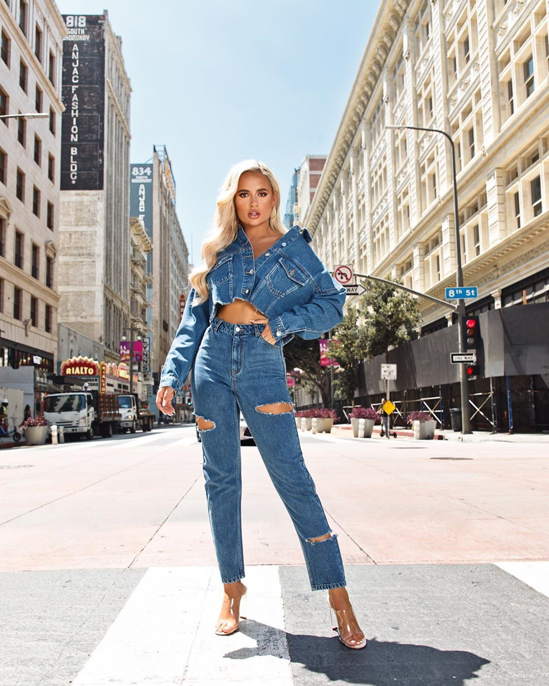 Image may contain:  Love Island 2019 contestants, Love Island, 2019, now, job, Instagram, updates, news, latest, series five, Molly-Mae Hague, Shoe, Female, Footwear, Building, Road, City, Street, Town, Urban, Light, Traffic Light, Human, Person, Denim, Jeans, Clothing, Pants, Apparel