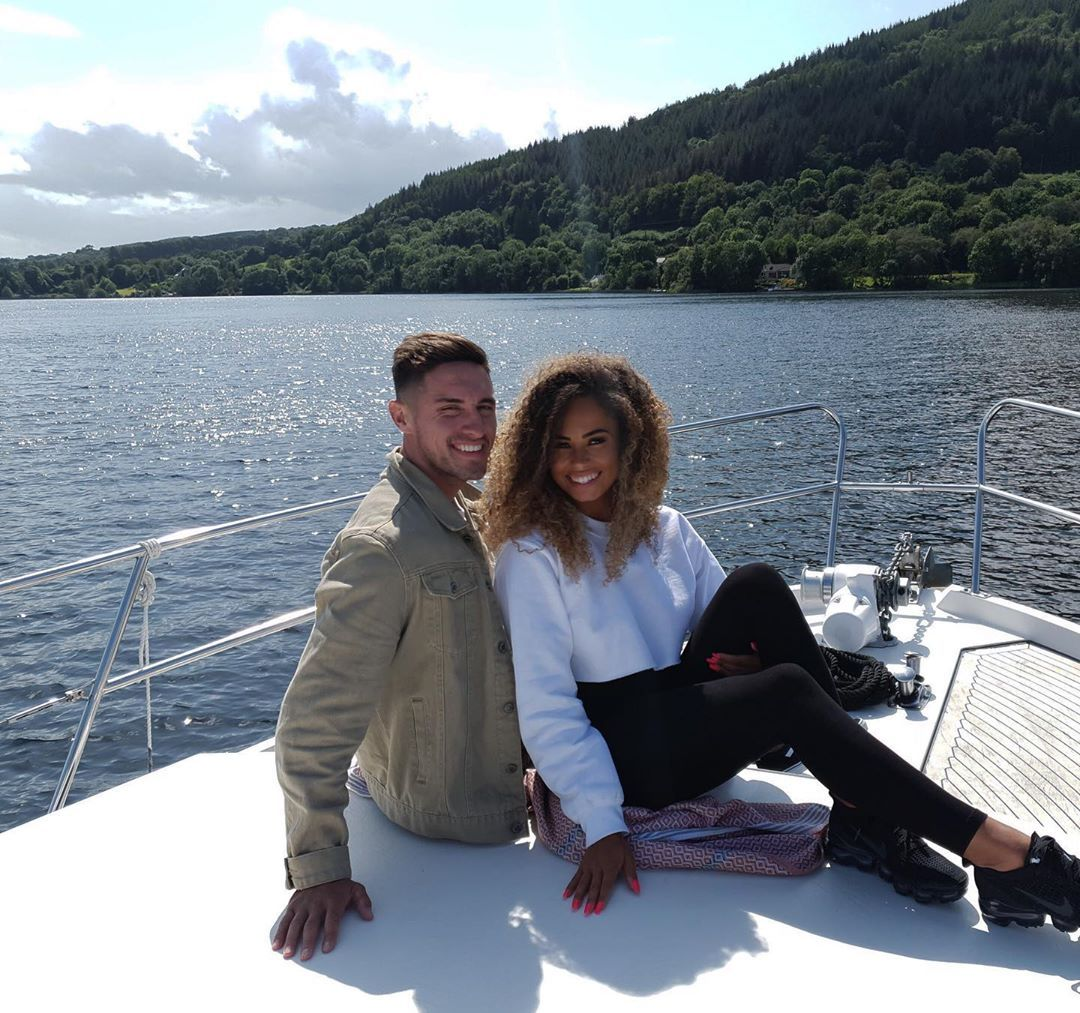 Image may contain: Amber and Greg split, Amber Gill, Greg OShea, Love Island, split, break up, text, reason, Shoe, Footwear, Sleeve, Sitting, Human, Person, Apparel, Clothing