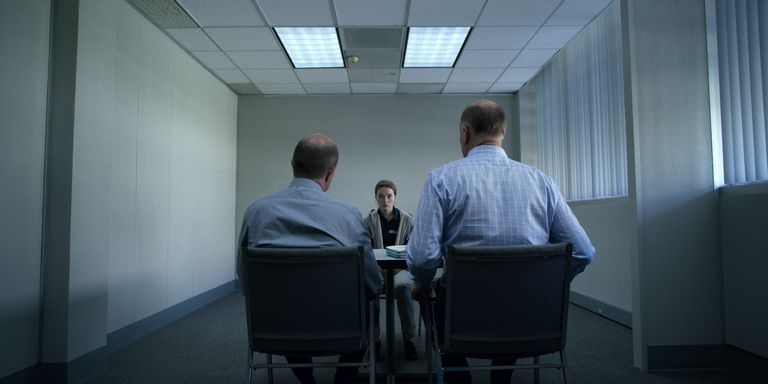 Image may contain: Marie Adler, Netflix, Unbelievable, real life, story, true crime, now, what happened, lie, truth, Marc O'Leary, police, investigation, case, updates, latest, news, Skylight, Meeting Room, Conference Room, Window, Architecture, Building, Indoors, Room, Human, Person, Chair, Furniture