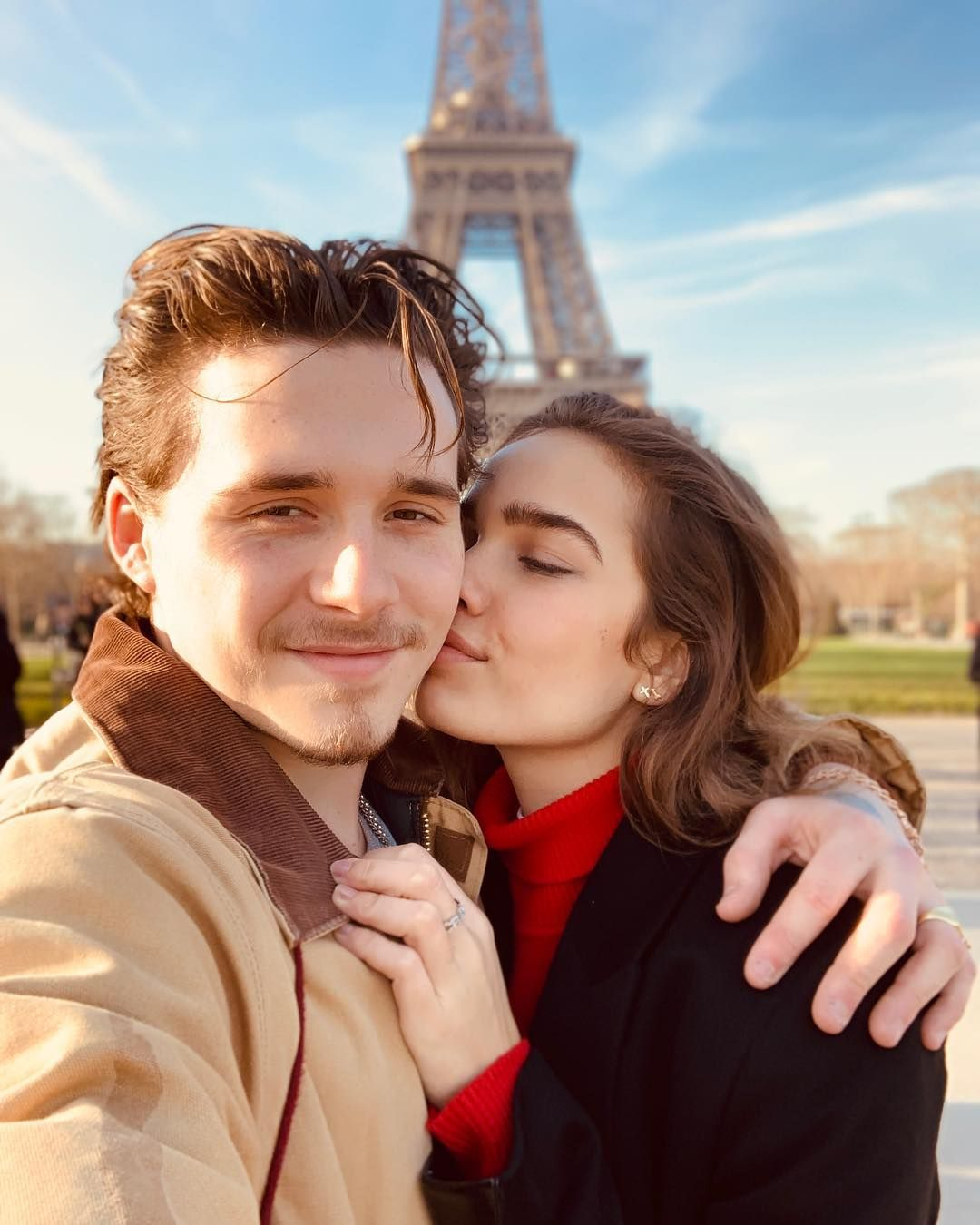 Image may contain: Brooklyn Beckham and Hana Cross, Brooklyn Beckham, Hana Cross, relationship, together, split, breakup, reason, argument, Paris, Valentine's Day, official, timeline, dating, drama, Instagram, Steeple, Spire, Architecture, Building, Tower, Person, Human