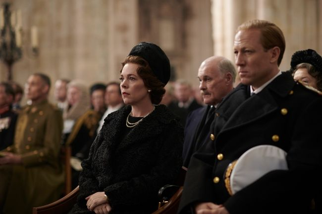 Image may contain: The Crown season three episode one, The Crown, season three, episode one, Netflix, how to watch, free, Officer, Funeral, Room, Court, Indoors, People, Military, Military Uniform, Crowd, Apparel, Clothing, Human, Person