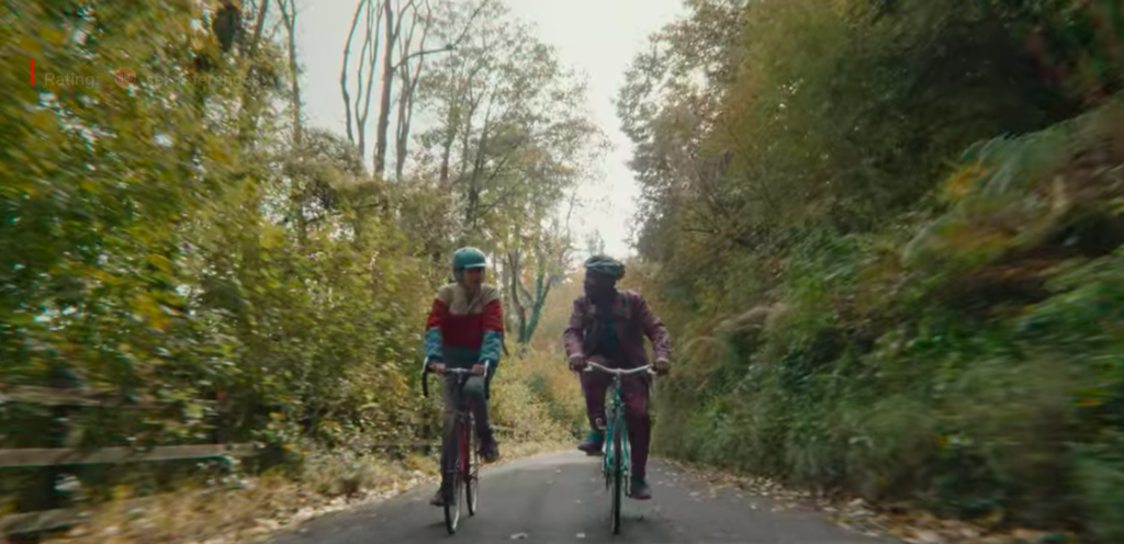 Otis and Eric bike ride to school across River Wye in Sex Education