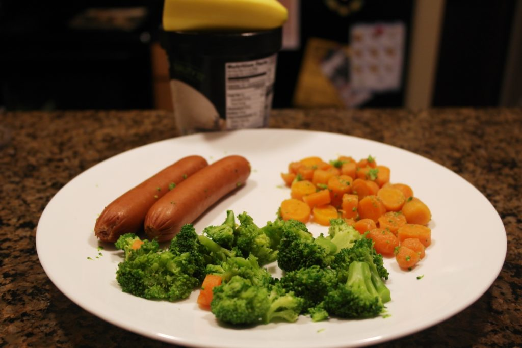2 hot dogs (without bun), 1 cup broccoli, 1/2 cup carrots, 1/2 banana & 1/2 cup vanilla ice cream