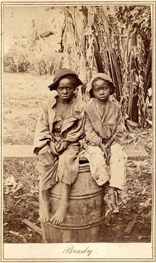An undated rare photo provided by Keya Morgan, found in a North Carolina attic, depicts two slave children, art historians say. In April, the photo was found at a moving sale in Charlotte, accompanied by a document detailing the sale of John for $1,150 in 1854. The picture was purchased for $30,000 by collector Keya Morgan. (AP Photo/Courtesy of Keya Morgan, LincolnImages.com)