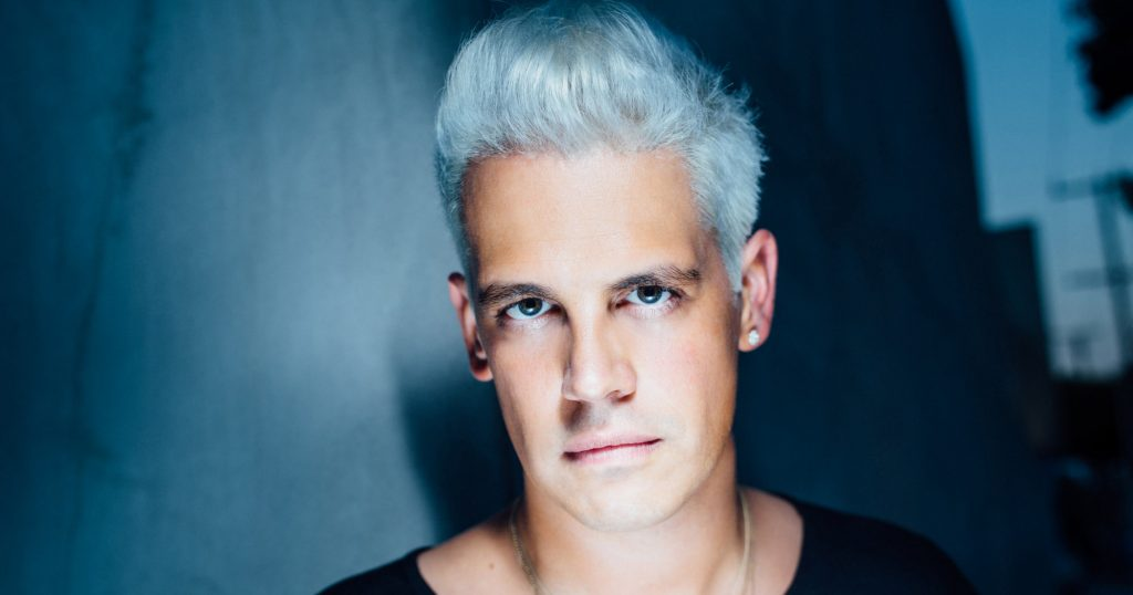 Milo Yiannopoulos picture with white hair and blue background