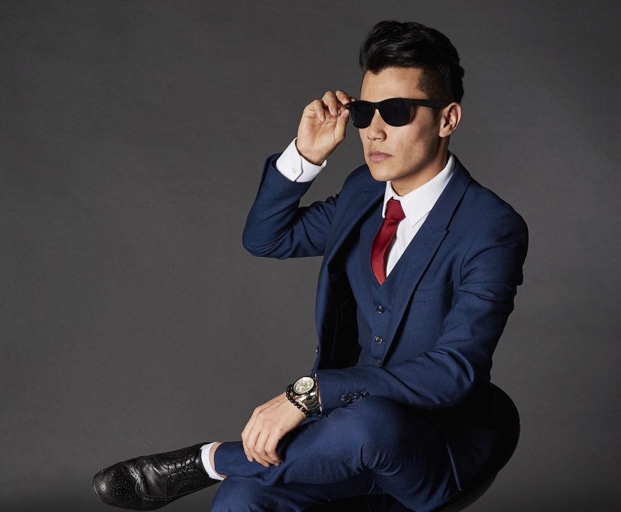d278cd83779 Nothing too high or showy. We d stay away from any bright colors or wild  patterns on shirts or ties. Suits should be in the navy or grey realm.