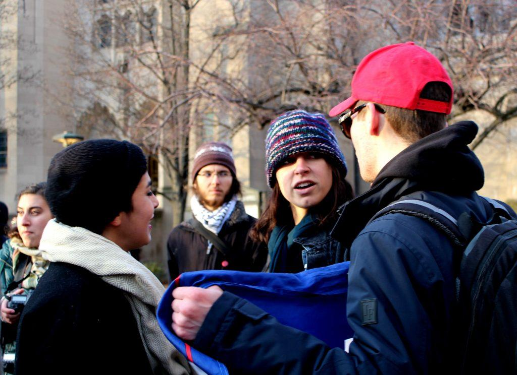 Fuentes at the January 30 anti-Islamophobia rally, where two girls (pictured) attacked him twice, despite organizers' wishes. Photo by Gabrielle Turi