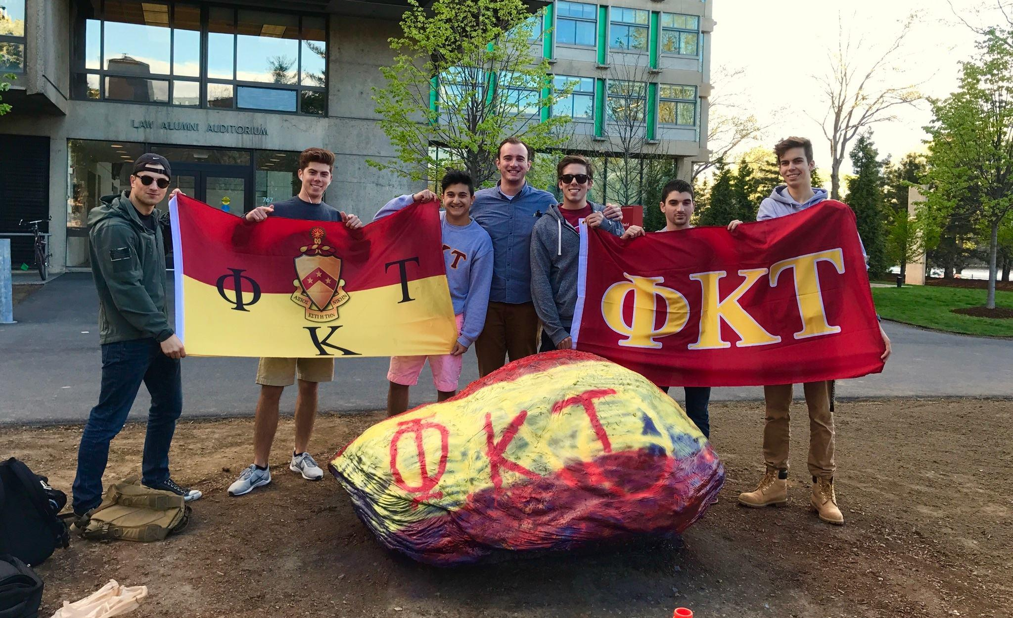 Members of the beta class in front of the BU Greek rock (L-R): John Mulligan, Matt Leonardo, Anthony Farhat, Ian Chamberland, Nick Madson, Andrew Levin, Adam Lazarchik.