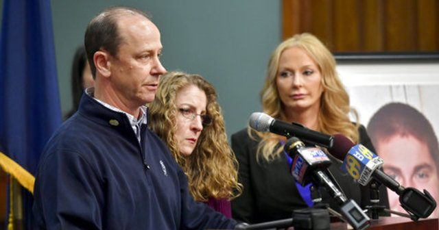 Tim Piazza's parents speak at a press conference with the DA