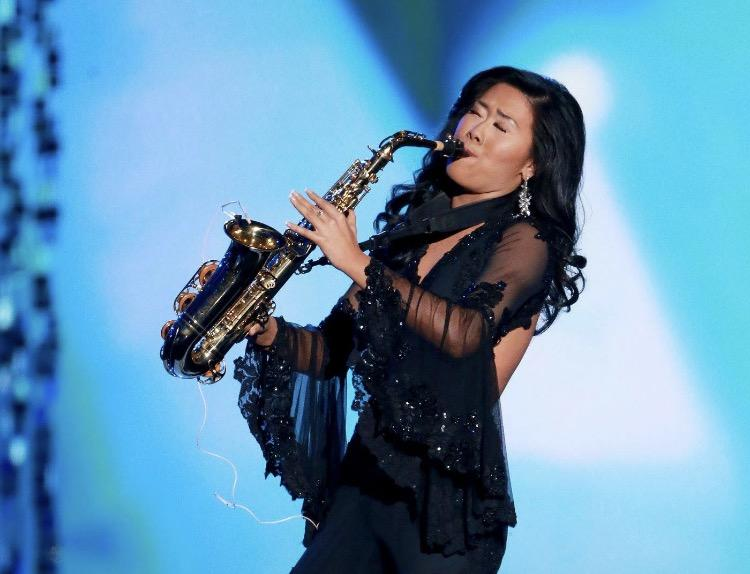 Schreckengast plays sax for her talent in Miss America