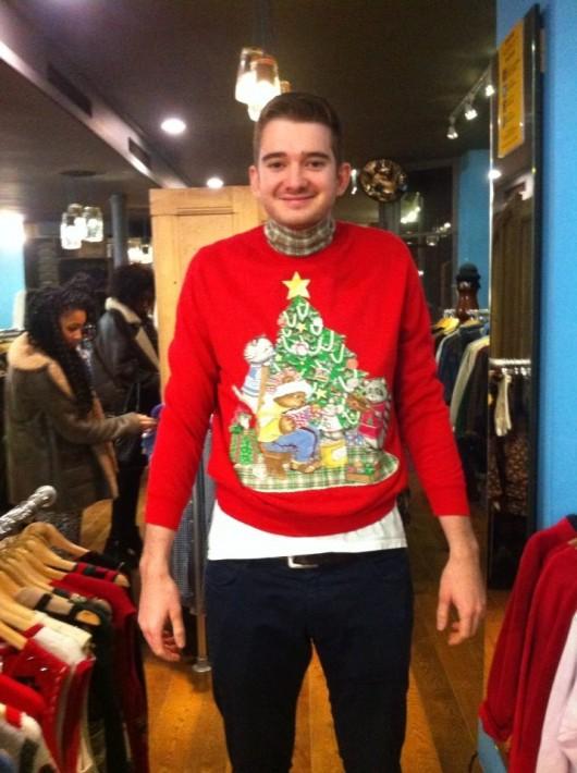 Tab legend Tom Jenkin struggles to find an appropriate piece of festive knitwear