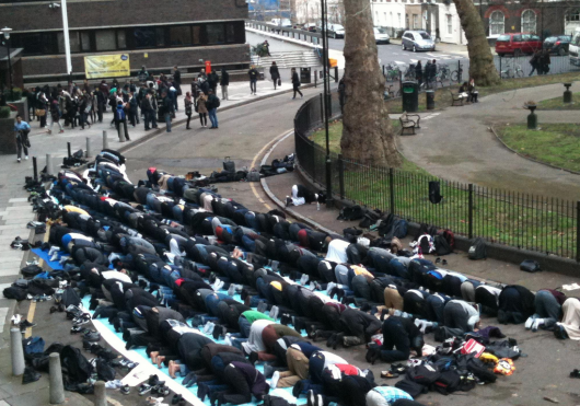 Students praying outside of City University London...