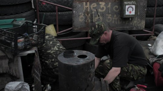 Preparing the molotov cocktails. Although many groups, both nationalists and far right remain armed on the streets of Kiev, these men only have molotov cocktails