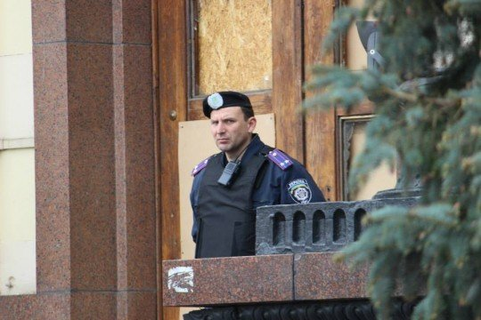 A police officer stands guard outside of the government building in Kharkiv. The windows had been broken in gunfights with pro-Russia gunmen who briefly occupied the building. They didn't like filming..