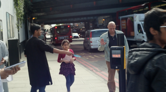 A passer-by refuses a leaflet from the Islamic Roadshow