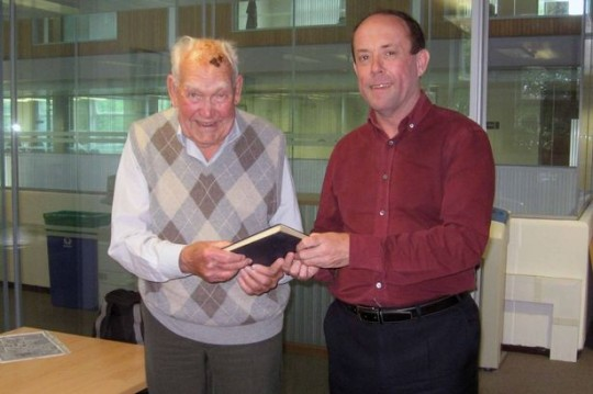 Ron hands over the book on primitive society61 years late