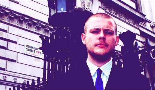 Joshua Bonehill frowning outside Downing Street