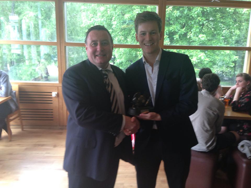 The man himself receives an end-of-year award from DUAFC's Club Captain