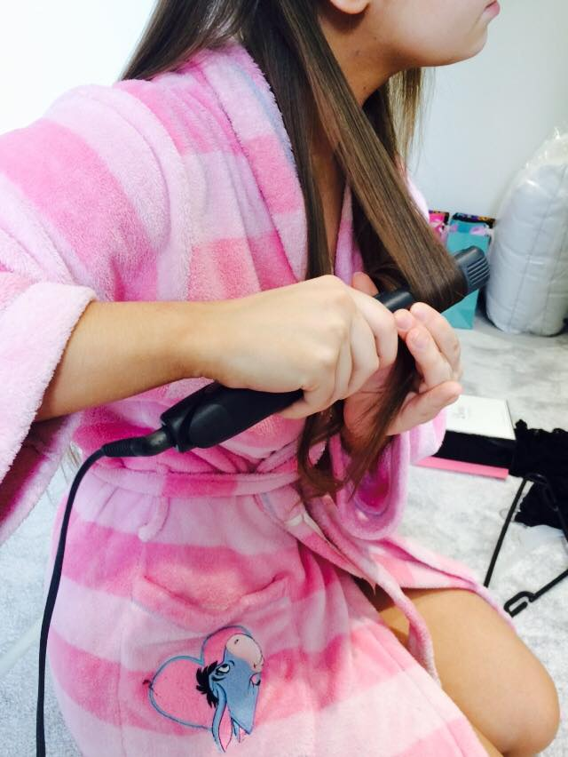 Turn the straighteners inwards at a 90 degree angle about half way down the section.