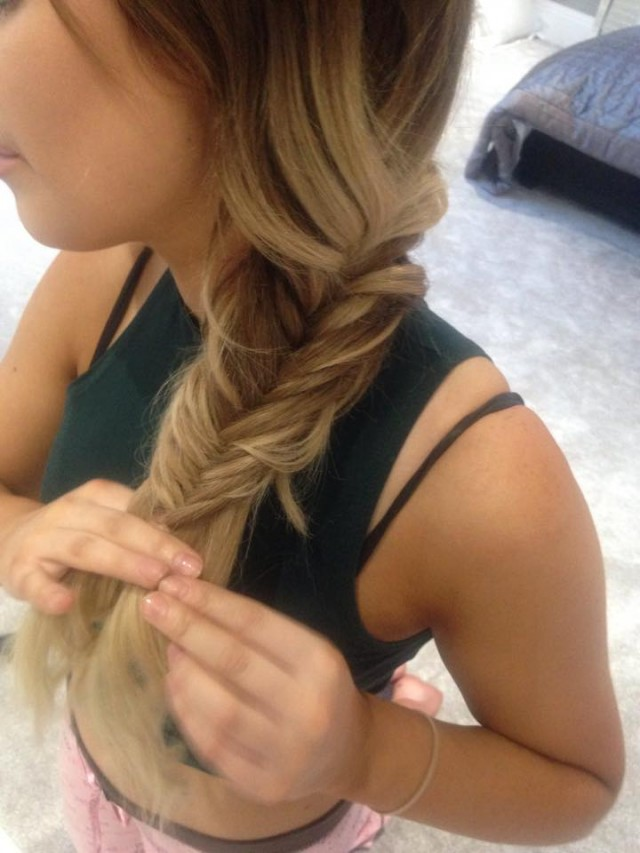 Continue this method, pulling the plait tight each time you bring the piece of hair over to the other section.