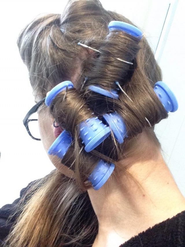 Repeat the process, rolling in the direction you want your curls to sit and securing with a hair clip/grip. The direction you roll the hair in will be essential if you have short hair - rolling towards your face will curl under and away from the face will give you flicks.
