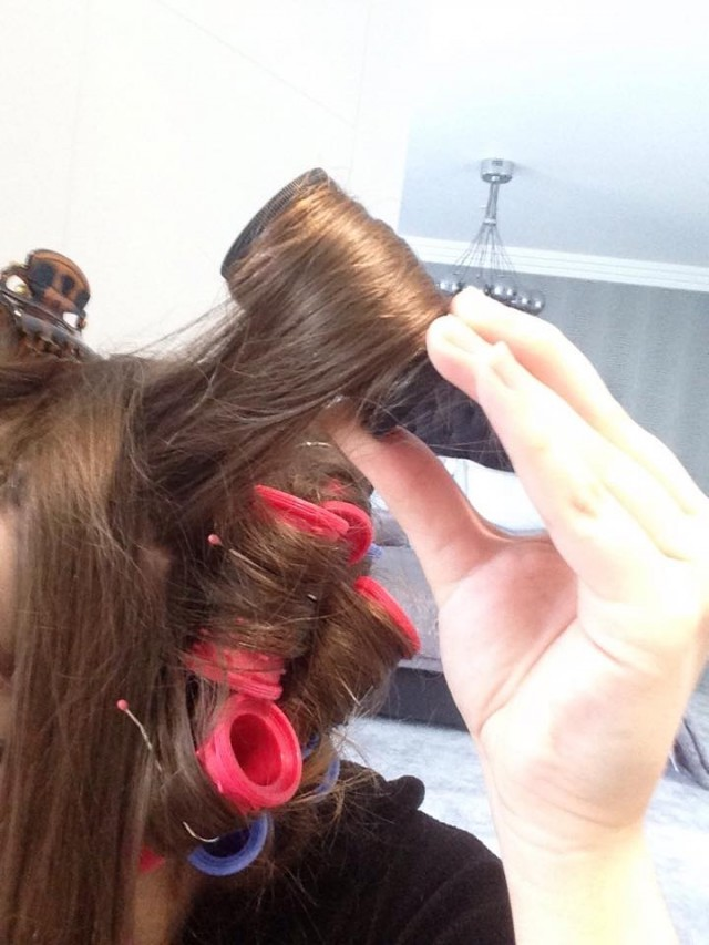 Use the larger rollers on the top of your head, pulling sections upwards and rolling down to create extra volume.
