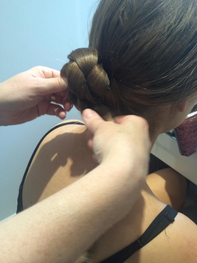Twist the plait into a low bun at the nape of the neck and secure with grips.