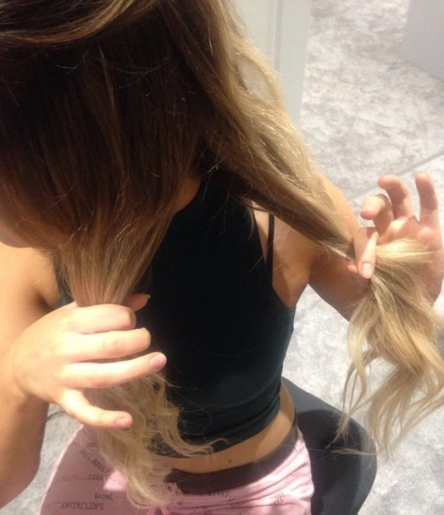 Take a small piece of hair from the outside of one of the sections and bring over to join the other section.
