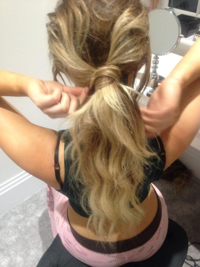 Wrap the small section of hair around the pony and secure on the underneath with a grip or two.