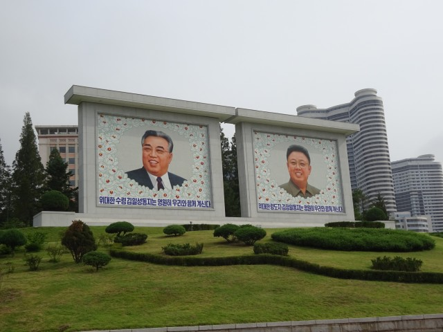 Mosaics of the supreme leaders surrounded by Kimilsungias