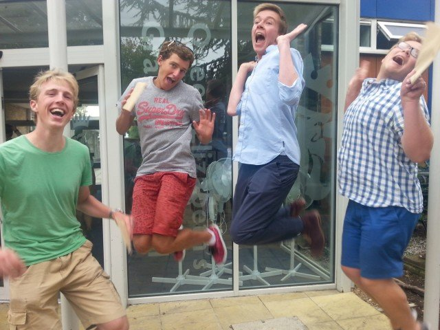 Boys at Queen Elizabeth's Grammar School pupils Seb Dickson, Joe Wareham, James Felton leap with joy as they recieve their A Level results, August 14 2014. The photo was taken in parody to the annual girls leap with A level results that appears in many newspapers.