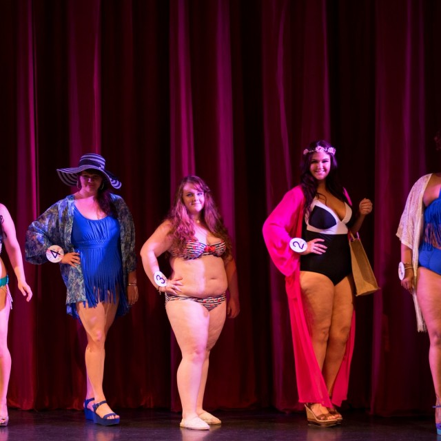Competitors take part in the swimwear round at the Miss British Beauty Curve 2015 pageant at the Epsom Playhouse in Epsom, Surrey. These buxom beauties prove that big really is beautiful as they strut their stuff at the Miss British Beauty Curve 2015 competition. See swns story SWCURVE. The pageant for plus-size women saw 27 contestants - ranging from a size 14 to a 26 - flaunt their figures onstage on Saturday evening at Epsom Playhouse, Surrey. After battling fashion-wear, swimsuit and evening gown rounds, it was Miss Preston Curve Rebecca Argent, 19, who walked away with the under-30 ÃMissà title last night, beating the 18 other women in this category. The gorgeous teen, whoÃs a size 18 and works in retail, said: ÃThis is the best day of my life à I canÃt stop crying! ÃIÃve always felt discriminated against and nervous because of being a bigger girl. I used to be the shy quiet girl who was bullied because sheÃs fat. ÃDoing this has changed me completely ÃIÃd never have stood up on a stage in swimwear or spoken in front of a crowd before entering. ÃThe best part about winning is being a positive role models to girls who were bullied in school like I was Ãto show them they donÃt have to be a size zero to be beautiful. They can be curvacious and still come away with a big sparkly crown. The winner of the ÃMsà title à for women aged 30 plus à was 31 year old Ms Surrey Curve Katherine Henry, who beat eight contestants to win first place.