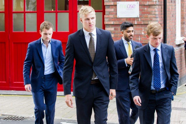 Patrick Foster, (left) Thady Duff (centre) and Leo Mahon (Right) (Dark haired man with yellow tie is a legal advisor) arrive at Gloucester Crown Court, Gloucestershire. 06 August 2015. Four farming students appeared in court accused of raping a female student at the summer ball of a prestigious agricultural university. See swns story SWRAPE. James Martin, 19, Patrick Foster, 21, Thady Duff, 22, and Leo Mahon, 20 were students at the Royal Agricultural University in Cirencester, Glos. on May 24 this year, when the alleged incident took place. The public gallery at Gloucester Crown Court was packed with friends and family of the young men, who spoke only to confirm their names. A further hearing has been scheduled for December 18, when the original charges are expected to be changed. Patrick Foster, from Colchester, Essex and Martin, of Chipping Norton, Oxfordshire, had originally each been charged with two offences of rape and one of assault by penetration. Duff, of Blunsdon, Swindon and Mahon, of Cirencester, Glos., were facing four offences of rape and one of assault by penetration. Duff had also been charged with one count of sexual assault and possession of extreme pornographic films. All four men have been released on bail to appear in court on December 18.