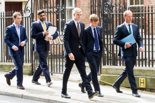 Patrick Foster ( left), Thady Duff (3rd from the left) and Leo Mahon (Second from right) Other men with folders are legal advisors arrive at Gloucester Crown Court, Gloucestershire. 06 August 2015. Four farming students appeared in court accused of raping a female student at the summer ball of a prestigious agricultural university. See swns story SWRAPE. James Martin, 19, Patrick Foster, 21, Thady Duff, 22, and Leo Mahon, 20 were students at the Royal Agricultural University in Cirencester, Glos. on May 24 this year, when the alleged incident took place. The public gallery at Gloucester Crown Court was packed with friends and family of the young men, who spoke only to confirm their names. A further hearing has been scheduled for December 18, when the original charges are expected to be changed. Patrick Foster, from Colchester, Essex and Martin, of Chipping Norton, Oxfordshire, had originally each been charged with two offences of rape and one of assault by penetration. Duff, of Blunsdon, Swindon and Mahon, of Cirencester, Glos., were facing four offences of rape and one of assault by penetration. Duff had also been charged with one count of sexual assault and possession of extreme pornographic films. All four men have been released on bail to appear in court on December 18.