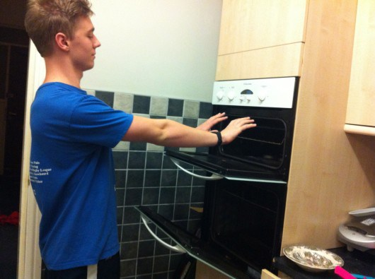 Switching on the oven to warm up your hands is probably not advice the NUS would give