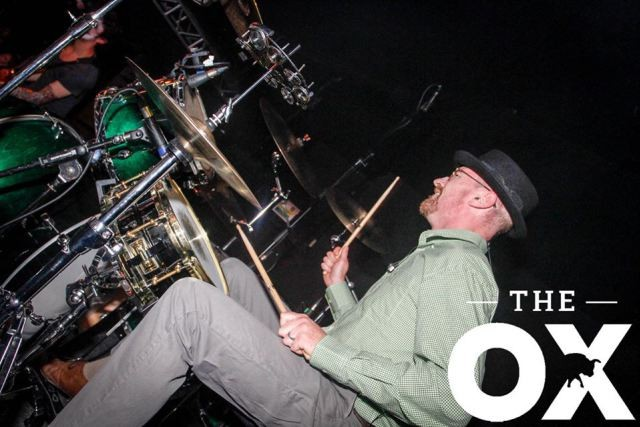 Looks like Walter White and plays the drums