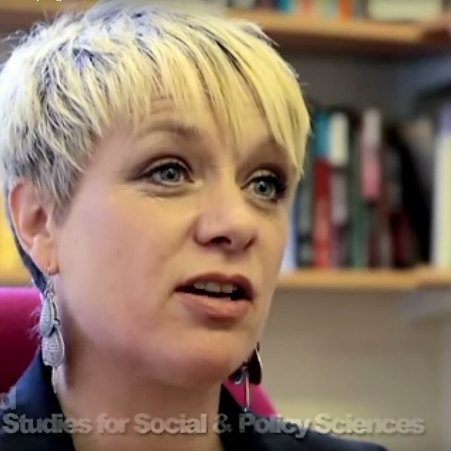 "University of Bath lecturer Leah Wild as seen in a promotional video. See SWNS story SWDRUNK; A lecturer at a top university has quit in disgrace after slapping a policewoman in the face as she was kicked off a plane for being drunk. Mum-of-three Leah Wild, 44, who taught sociology at the University of Bath, started downing duty free Jack Daniels and brandy when her holiday flight was delayed. The Ryanair plane, carrying 184 passengers to Faro in Portugal, was stuck on the tarmac at Bristol for three hours because of a strike by French air traffic controllers. A court heard that Wild and friend Reuben Crowe, 23, became ""clearly drunk"" and were talking loudly and listening to loud music."