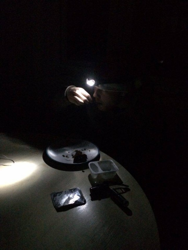 Helena and her flatmate trying to eat in the dark