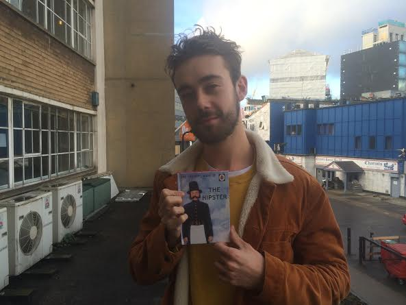 A hipster with his hipster book