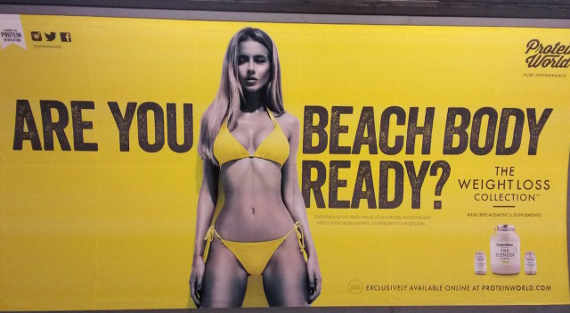 "A Protein World advert displayed in an underground station in London which says ""Are you beach body ready?"" as a petition calling for its removal gathers tens of thousands of signatures. PRESS ASSOCIATION Photo. Picture date: Monday April 27, 2015. The Advertising Standards Authority (ASA) said it has received 216 complaints about the ad, and a spokeswoman said the general nature of the complaints is that the ad is ""offensive, irresponsible and harmful because it promotes an unhealthy body image"". An investigation has not been launched but the ASA said they are ""carefully assessing"" the complaints to ""establish if there are grounds for further action"". See PA story HEALTH Body. Photo credit should read: Catherine Wylie/PA Wire"