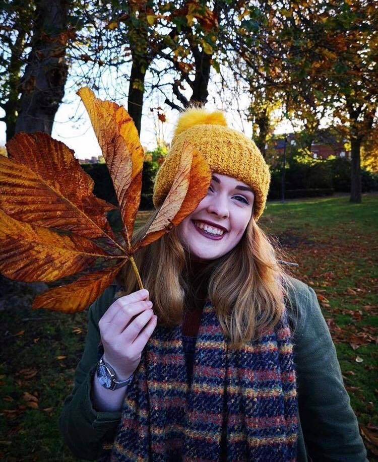 Image may contain: Woman, Grass, Woodland, Forest, Nature, Land, Photography, Portrait, Photo, Girl, Sweater, Laughing, Outdoors, Smile, Female, Vegetation, Tree, Person, Face, Human, Clothing, Apparel, Plant, Leaf